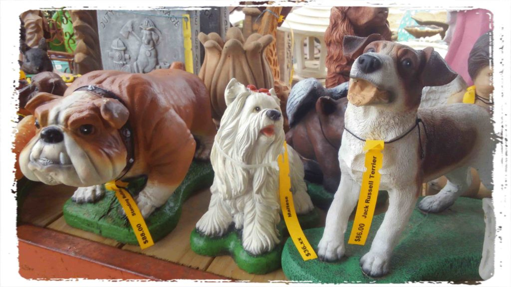 We have many dog and pet painted statues to choose from!