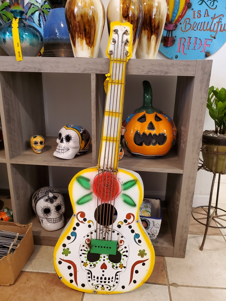 You'll have a scream with this talavera sugar skull metal decoration!