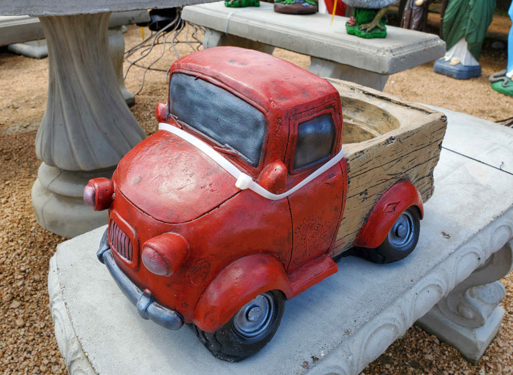 Cement vintage pickup truck that doubles as a planter!  Plant some colorful flowers and go cruising downtown!