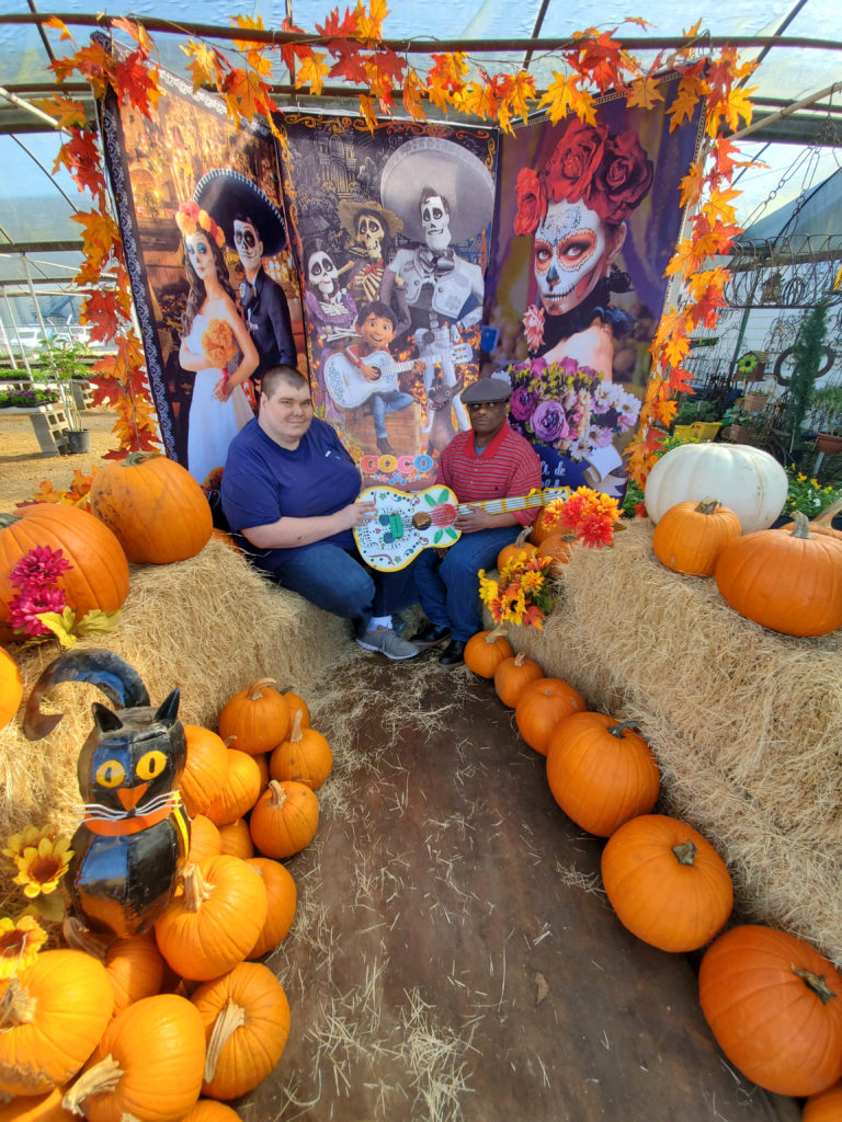 Customers with hay bales, pumpkins (Casper, pumpkin and pie), black cat and metal, sugar skull guitar!