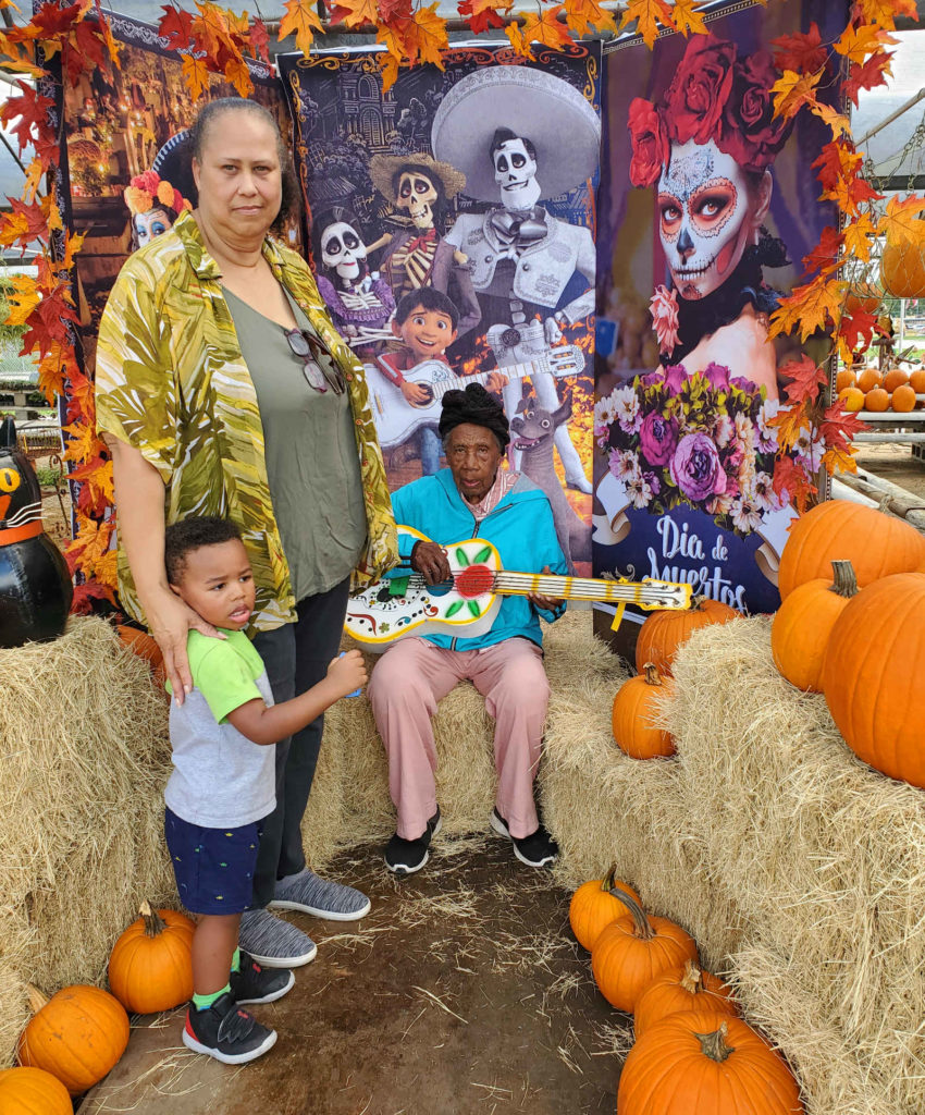 Family photo with metal guitar and pumpkins!