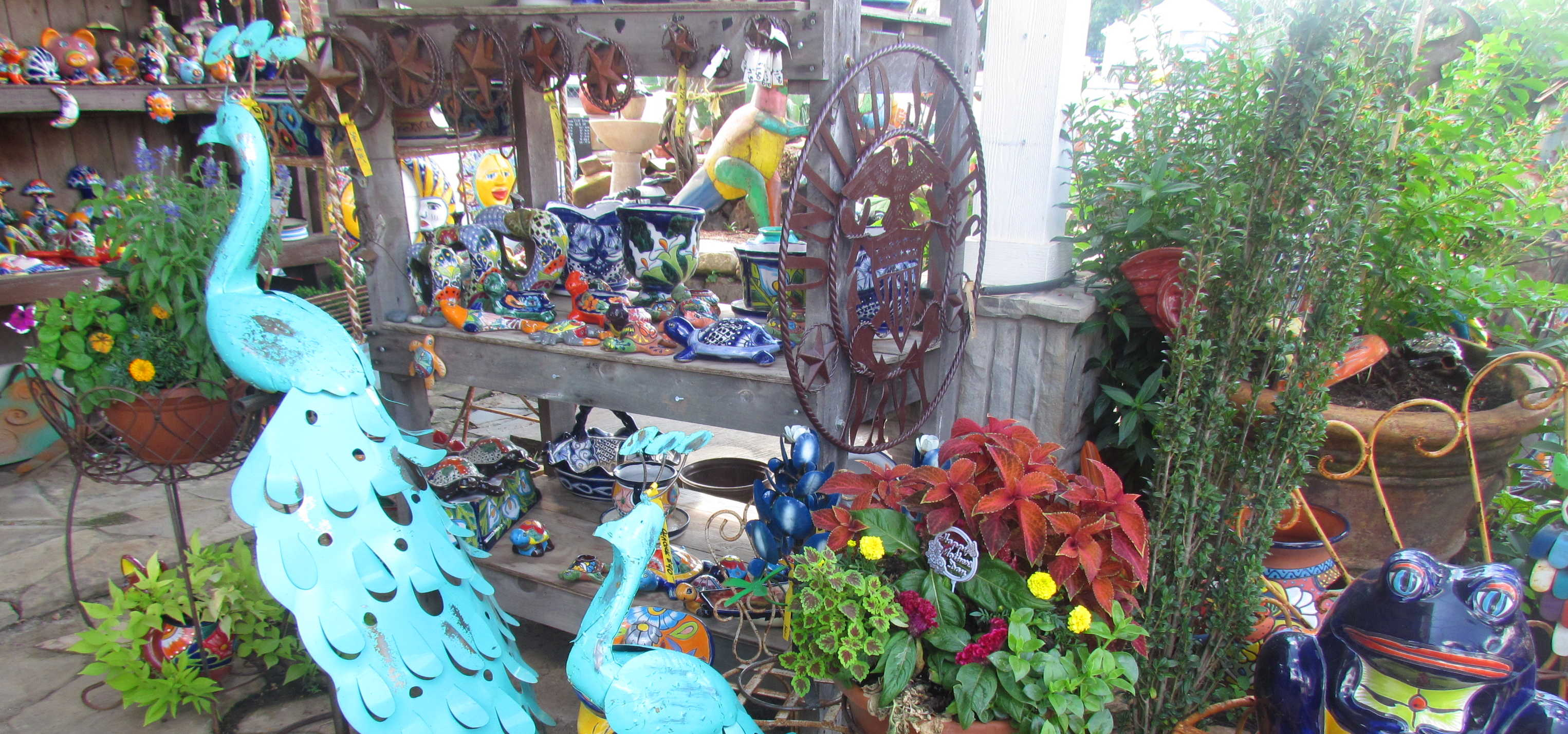 Yard decorations, Cement Statues, Talavera Pottery, Iron Decorations and more at Madison Gardens Nursery, Spring, TX.