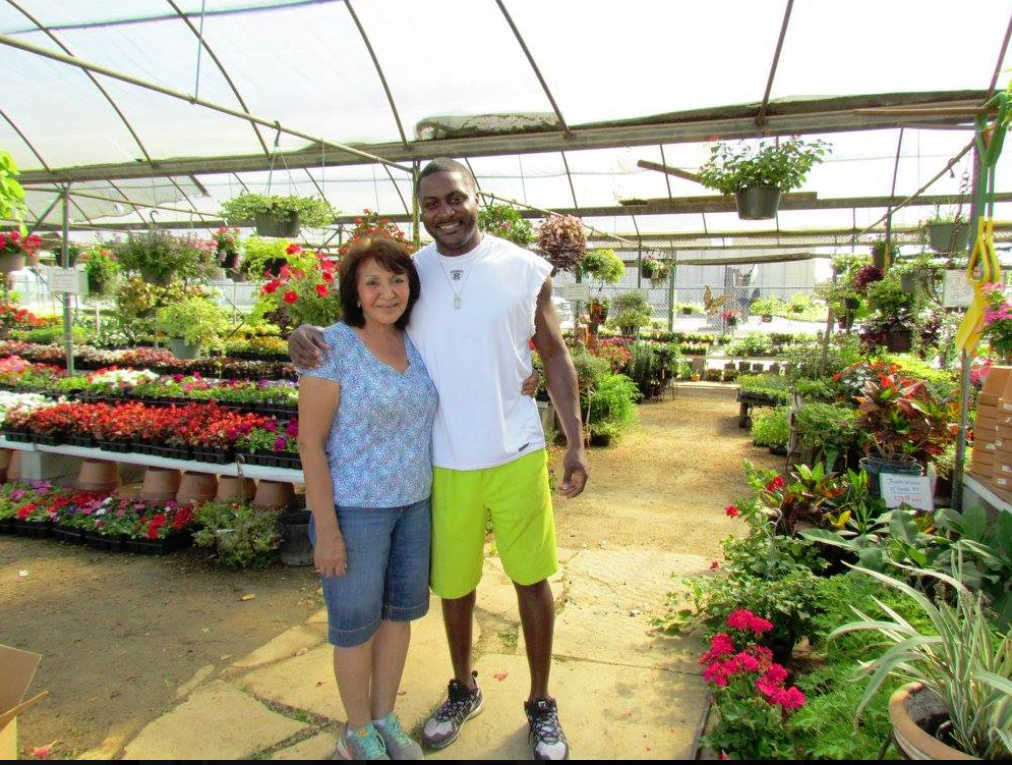 Chris Cole visiting the nursery with Gloria!