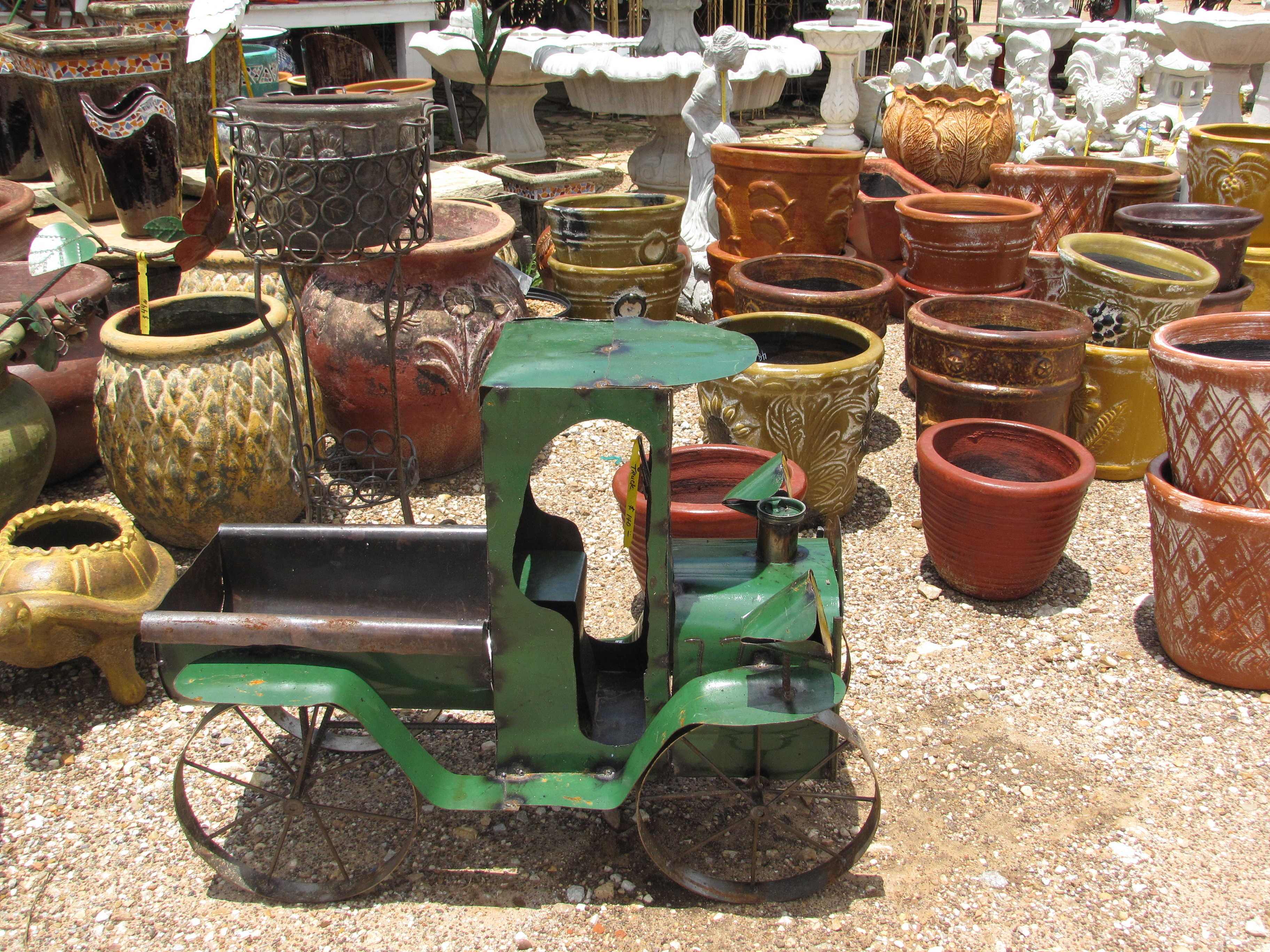 Many kinds of yard decor such as iron, cement and pottery at Madison Gardens Nursery, Spring, TX.