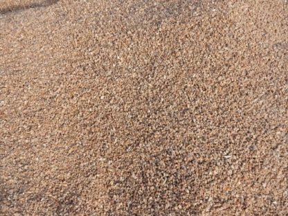 Pea Gravel. Often used for pathways and dog runs.