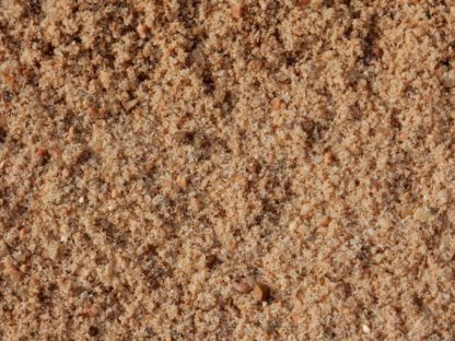 Torpedo Sand. Often mixed with cement. Can be used for help with drainage, too.